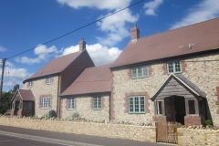 Medium Faced Flint Stone Houses with Large Faced Flint Stone Wall