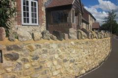 Large Faced Flint Stone Wall with Medium Faced Flint Stone House